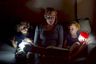 Matthew Emily And Tommy Izzard Reading By Torchlight Ready For Earth Hour  TBW Newsgroup