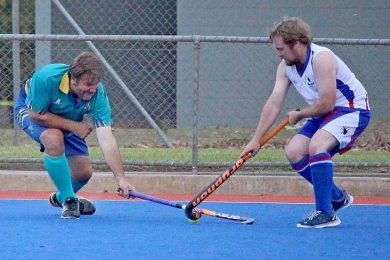 West Veteran Andrew Widdison Goes To The Left Hand In Attempting To Gain Possession From Redbacks Chris Muller In Division 2 Men  TBW Newsgroup