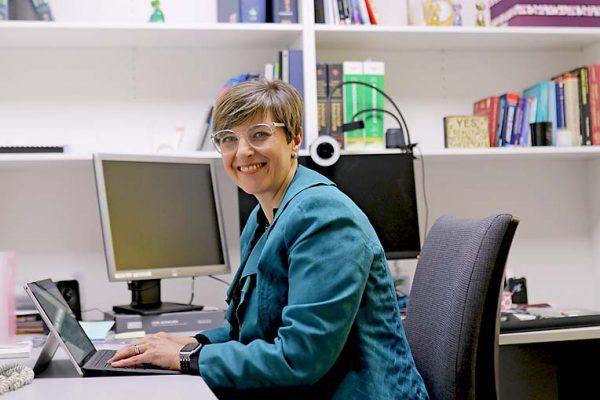 Elaine Pretouris At Desk TBW Newsgroup